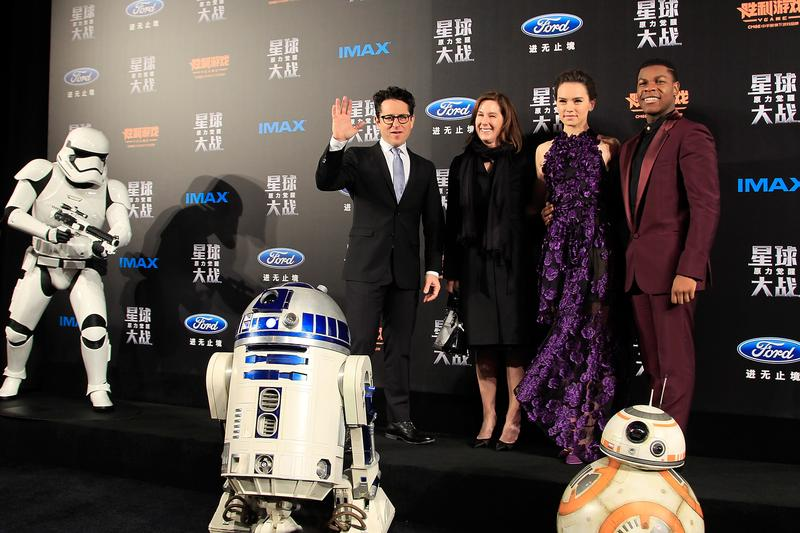 From left to right, J.J. Abrams, Kathleen Kennedy, Daisy Ridley, John Boyega, attend the premiere of Star Wars on December 27, 2015 in Shanghai, China.