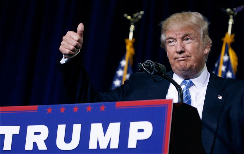 Republican presidential nominee Donald Trump gives a thumbs up to the crowd during a campaign rally on August 31, 2016 in Phoenix, Arizona.