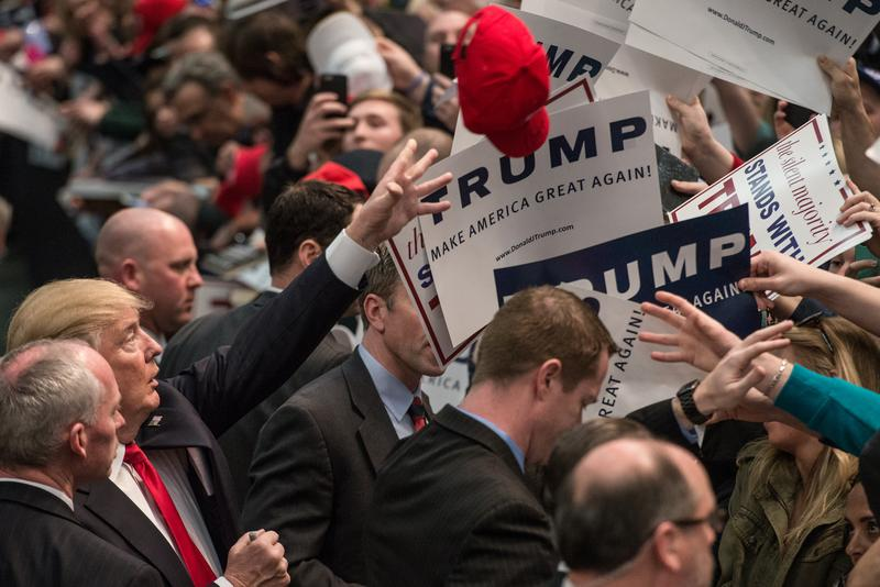 Republican presidential candidate Donald Trump signs autographs at a campaign rally March 7, 2016 in Concord, North Carolina.