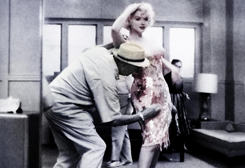 """Costume designer Orry-Kelly pinning up Marilyn Monroe's dress from """"Some Like It Hot,"""" in a scene from Gillian Armstrong's new movie."""