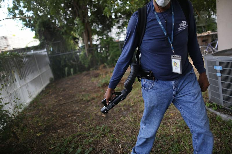 Larry Smart, a mosquito control inspector, sprays pesticide in the Wynwood neighborhood as the county fights to control the Zika virus outbreak on August 1, 2016 in Miami, FL.