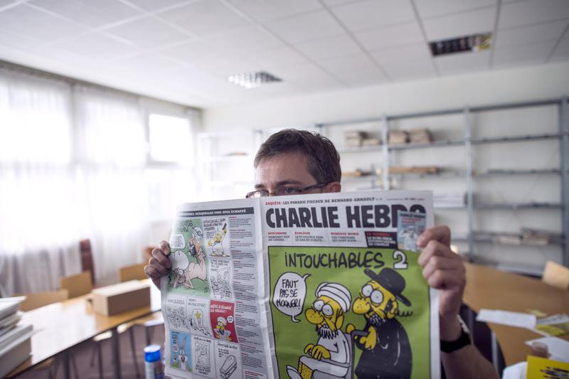 French satirical weekly Charlie Hebdo's publisher and cartoonist, known only as Charb, presents the last issue.