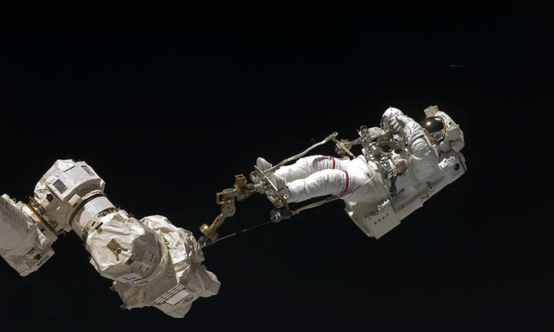Astronaut Dave Wolf performing a spacewalk on the Endeavour in July, 2009.