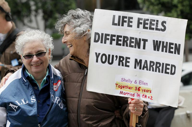 Same-sex couple Shelly Bailes (L) and Ellen Pontac celebrate the ruling to overturn the ban on gay marriage outside of the Philip Burton Federal building August 4, 2010 in San Francisco, California.