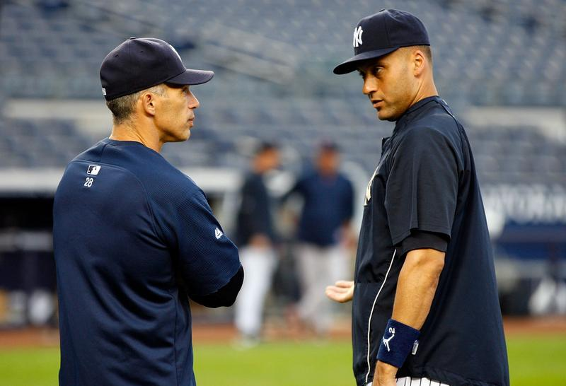 Manager Joe Girardi #28 and Derek Jeter #2 of the New York Yankees talk during warm-ups prior to their game against the Boston Red Sox on September 26, 2010 at Yankee Stadium.