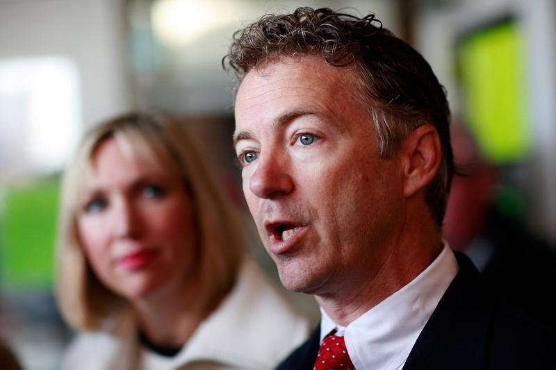 Rand Paul, Kentucky's Senator-elect, and his wife, Kelley, talk with reporters after casting their ballots November 2, 2010 in Bowling Green, Kentucky.