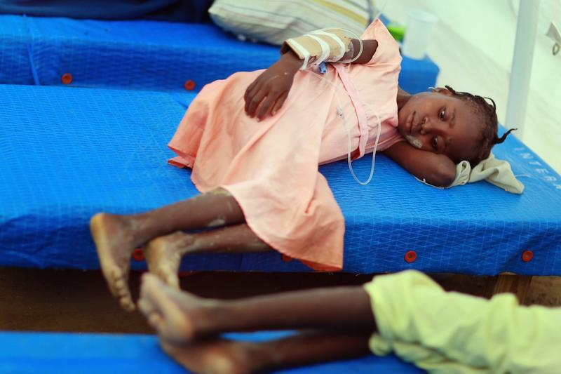 Children lay on a cots as they are being treated for cholera in a Samaritan's Purse cholera treatment facility on November 24, 2010 in Cabaret, Haiti.