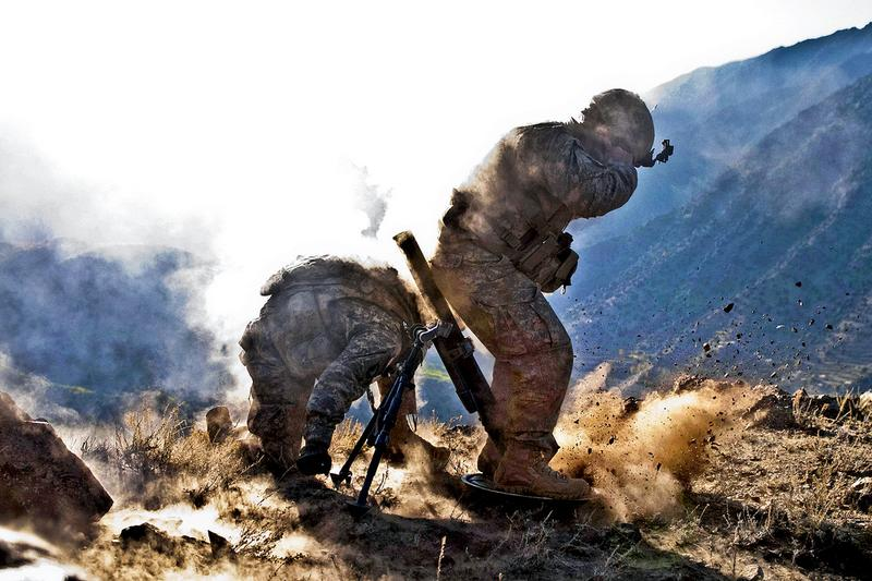 Sgt. Richard A. Darvial and Spc. Corey C. Canterbury fire a mortar in eastern Afghanistan Dec. 11.