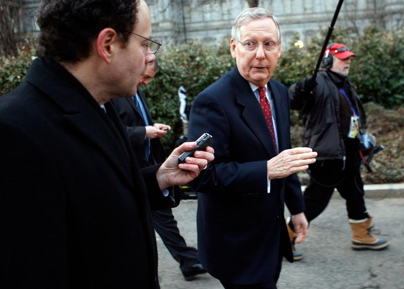 Senate Minority Leader Mitch McConnell (R-KY) (R) speaks to a member of the media after U.S. President Barack Obama hosted a meeting at the Blair House.