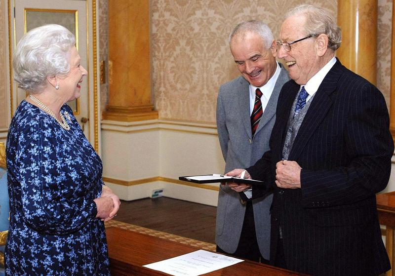 Britain's Queen Elizabeth II (L) presents the inaugural Queen's Medal For Music to Australian musician Sir Charles Mackerras (R) at Buckingham Palace in London.