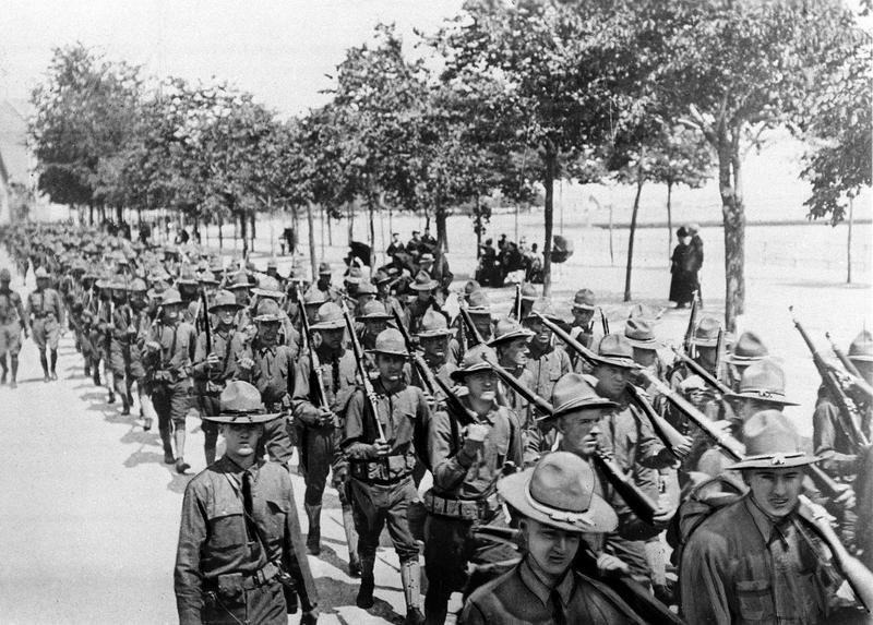 U.S. troops of the 1st Division, the first American troops to land on French soil, parade in St. Nazaire, France, June 26, 1917 during World War I.