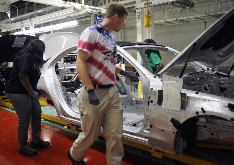 David Reeves inspects a new sedan at the Mercedes-Benz factory in Vance, Ala.