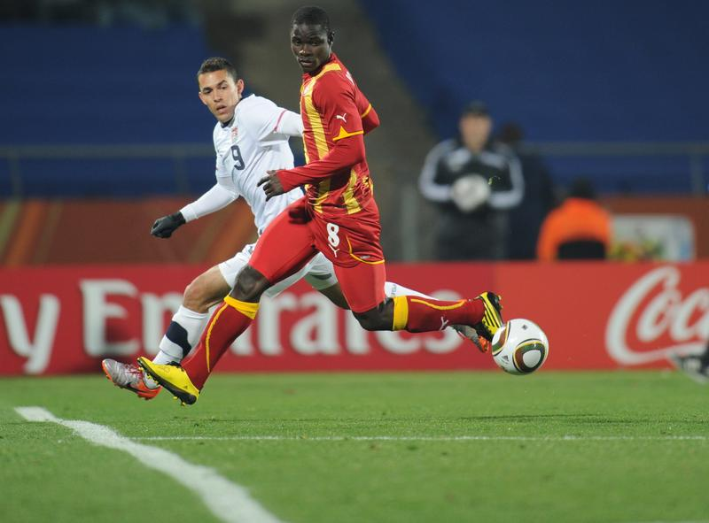 U.S. midfielder Herculez Gomez (L) fights for the ball with Ghana's defender Jonathan during the 2010 World Cup.
