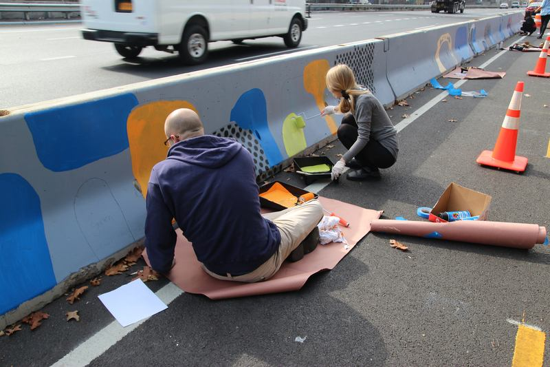 The New York City Department of Transportation's Urban Art Program, New York Cares and the Mayor's Community Affairs Unit organized two Barrier Beautification painting events.