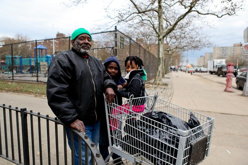Eddie Span, his son and niece a few days after Sandy. Span said NYCHA hadn't done anything to help residents of the Hammel Houses.