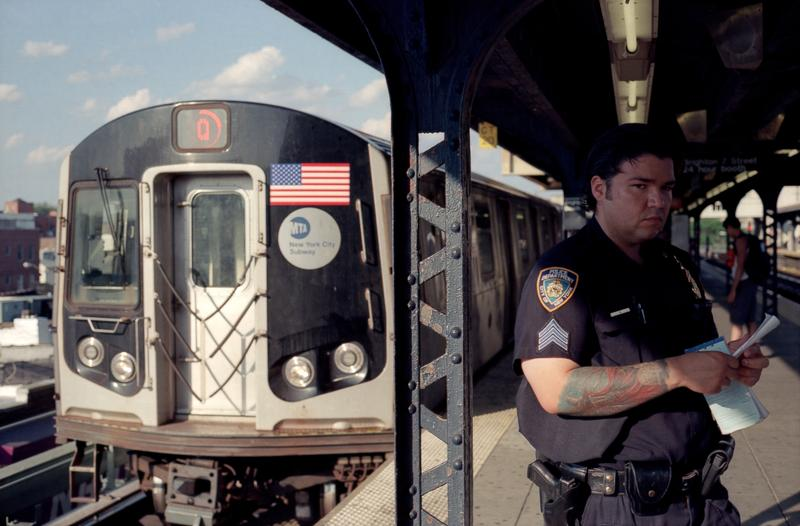 NYPD officer on NYC subway platform