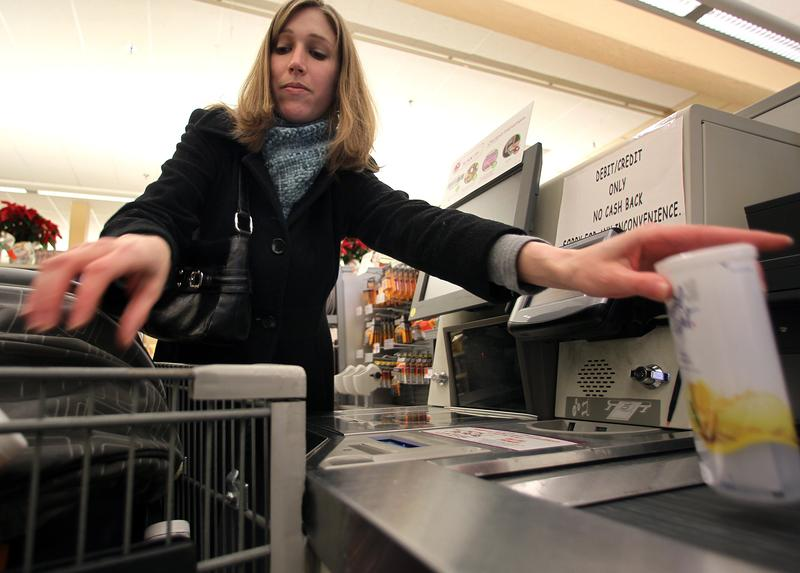 At the grocery store chain Stop and Shop, Alicia Morgans from the Boston neighborhood of Jamaica Plain scans her order in at the self-checkout.