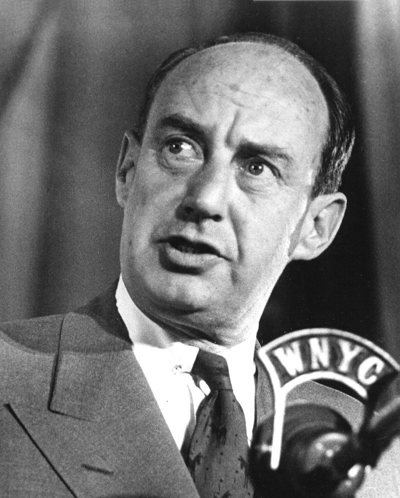 Caption:Portrait of American politician and diplomat Adlai Stevenson (1900 - 1965) as he speaks behind a WNYC microphone, New York, New York, 1952.