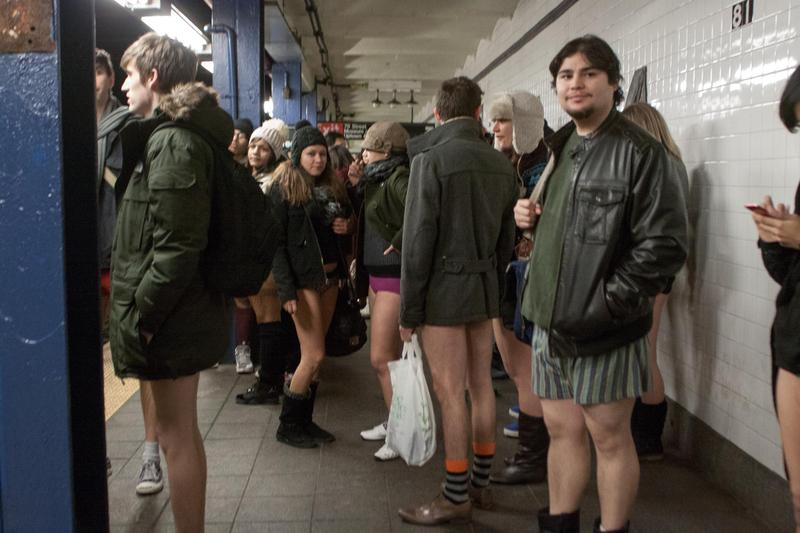 Look ma, no pants: participants in the annual pants-free subway ride wait for a C train