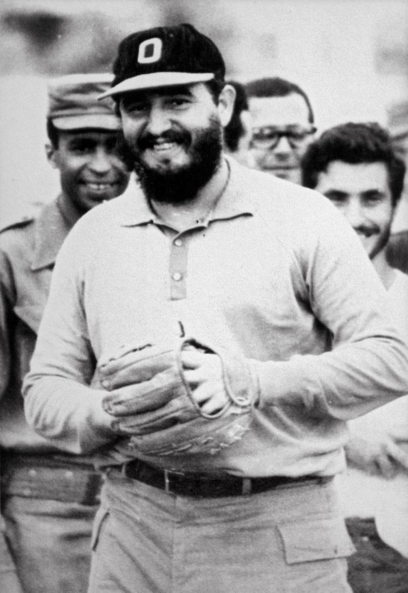Cuban President Fidel Castro laughs during a baseball match between his 'rebels' in Havana, shortly after toppling dictator Fulgencio Batista in January, 1959.