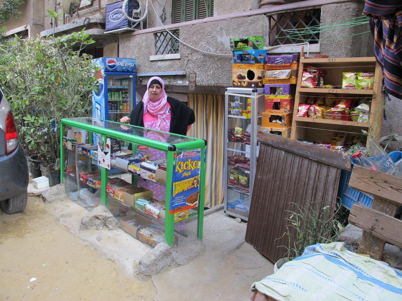Om Fathi runs a kiosk out of her small basement apartment in central Cairo.