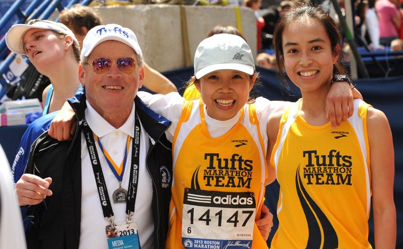 Coach  Don Megerle with members of the Tufts marathon team.