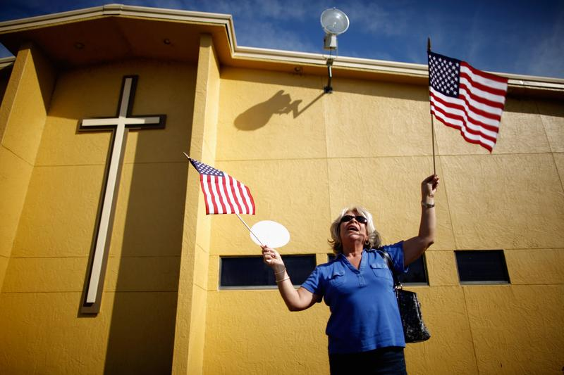 A supporter of Republican presidential candidate and former Speaker of the House Newt Gingrich (R-GA) waits for his arrival outside Centro de la Familia evangelical church January 28, 2012.
