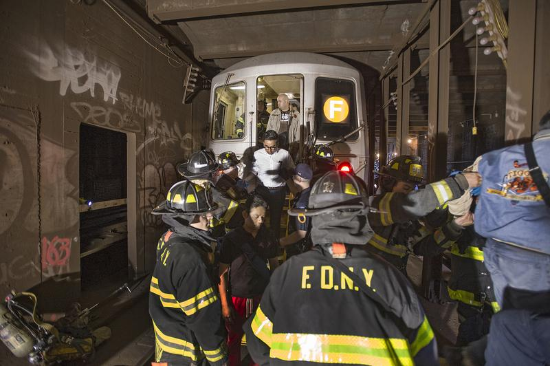 Emergency service workers responded to the derailment of an F train under Broadway and 60th Street in Woodside, Queens, on May 2, 2014.