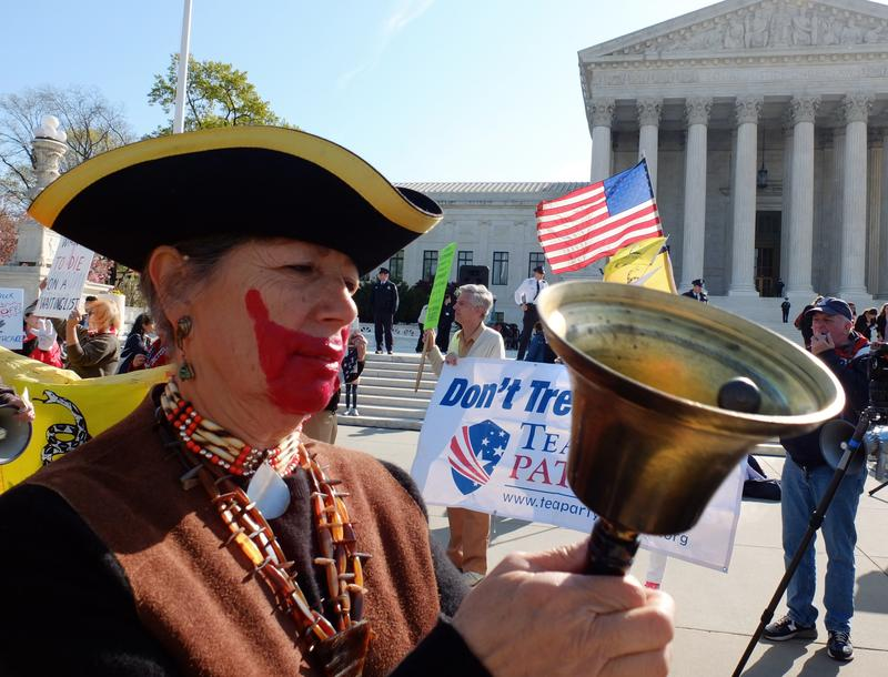 A tea-party supporter protest outside the US Supreme Court on the third day of oral arguements over the constitutionality of the Patient Protection and Affordable Care Act