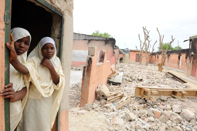 Female student stands in a burnt classroom at Maiduguri Experimental School, which was burnt by the Islamist group Boko Haram to keep children away from school. May 12, 2012
