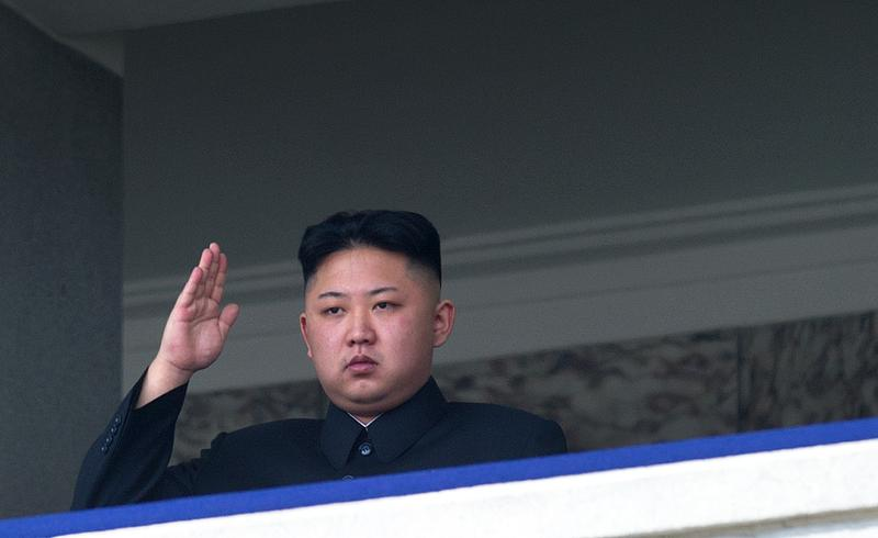 This file photo taken on April 15, 2012 shows North Korean leader Kim Jong-Un saluting as he watches a military parade to mark 100 years since the birth of the country's founder and his grandfather.