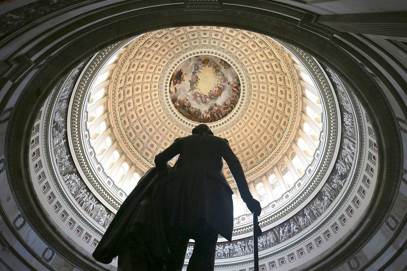 A statue of George Washington stands in the Rotunda of the U.S. Capitol August 28, 2012 on Capitol Hill in Washington, DC. It has been reported that the dome of the Capitol has 1,300 known cracks.