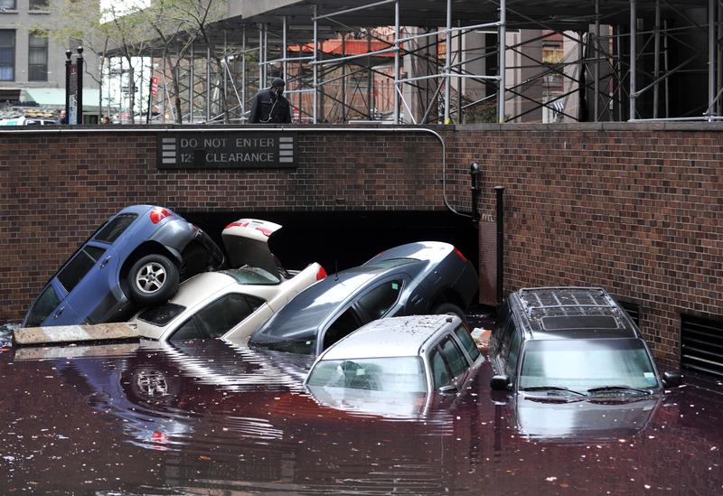 Cars piled on top of each other at the entrance to a garage on South Willliam Street in Lower Manhattan October 31, 2012 in New York as the city begins to clean up after Hurricane Sandy.