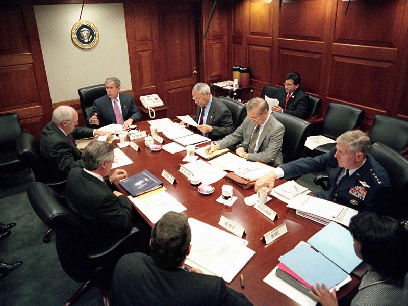 President George W Bush meets with top security and government officials in the White House Situation Room, during the aftermath following the September 11th, 2001 terrorist attacks.