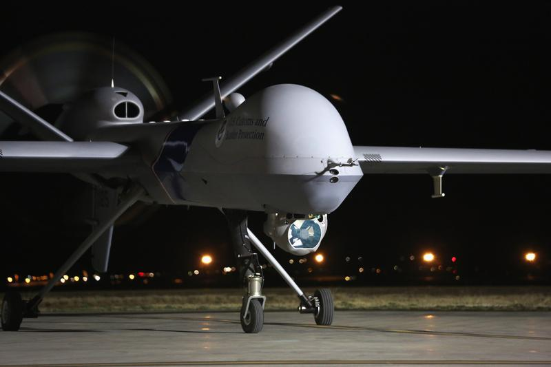 A Predator drone operated by U.S. Office of Air and Marine (OAM), taxis towards the tarmac for a surveillance flight near the Mexican border on March 7, 2013 from Fort Huachuca in Sierra Vista, AZ.