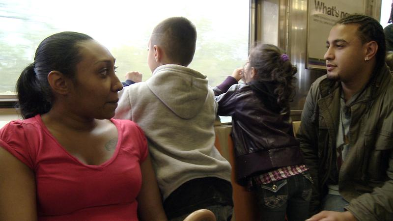 Hannah, Philly, and Hannah's two children ride the subway together during one of their weekend visits.