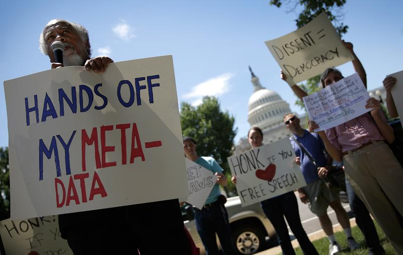 Protesters rallying outside the U.S. Capitol against the NSA's detailed surveillance programs in June of 2013.