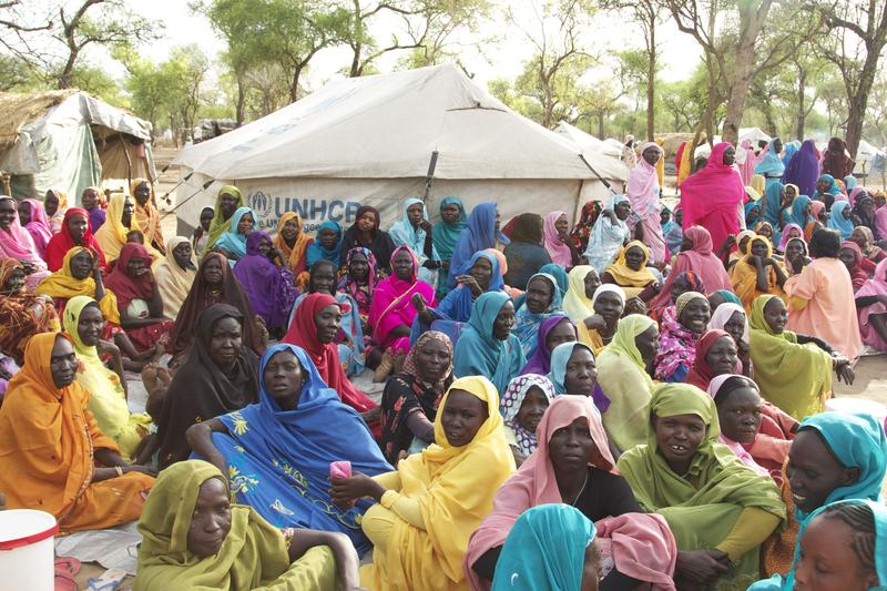 Women gather in a refugee camp.