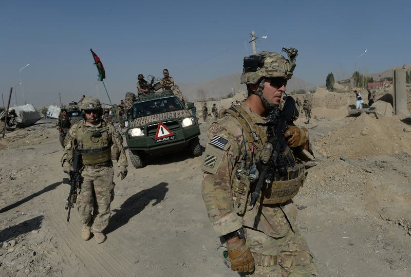 US soldiers arrive at the site of a suicide attack in Maidan Shar, the capital city of Wardak province south of Kabul on September 8, 2013.