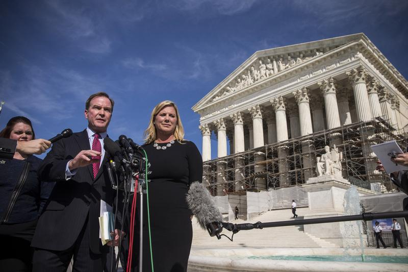 Michigan Attorney General Bill Schuette (L) speaks during a press conference after going before the Supreme Court in 'Schuette v. Coalition to Defend Affirmative Action.' Oct. 15, 2013