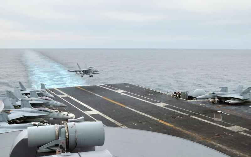 This photograph taken on October 24, 2013 in the South China Sea shows a US fighter jet making its landing on the USS George Washington aircraft carrier.
