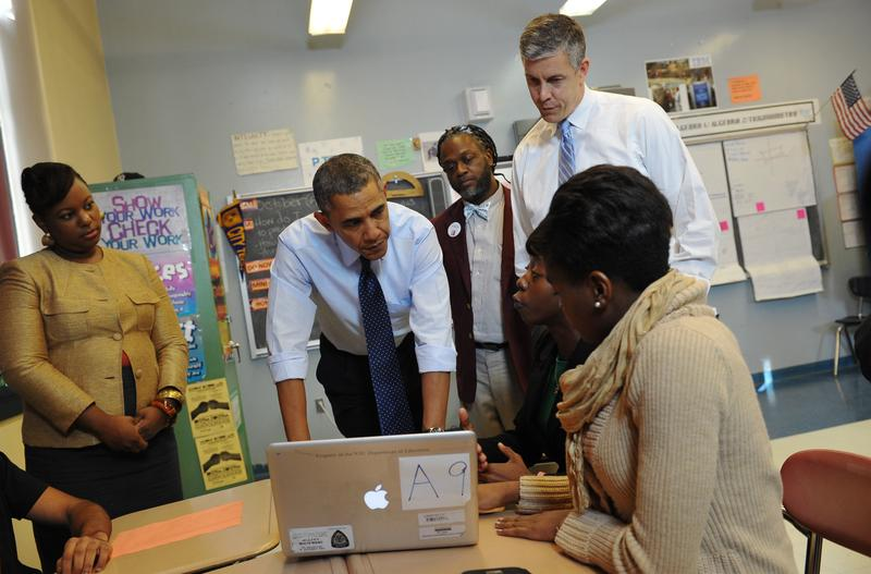 US President Barack Obama and Education Secretary Arne Duncan (R) visit a classroom at Pathways in Technology Early College High School in Brooklyn, New York on October 25, 2013.