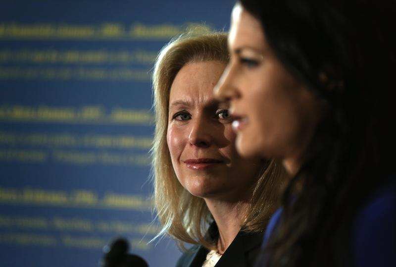 Former Marine officer & military sexual assault victim Ariana Klay (R), speaks as U.S. Sen. Kirsten Gillibrand (D-NY) (L) listens during a news conference November 6, 2013 on Capitol Hill.