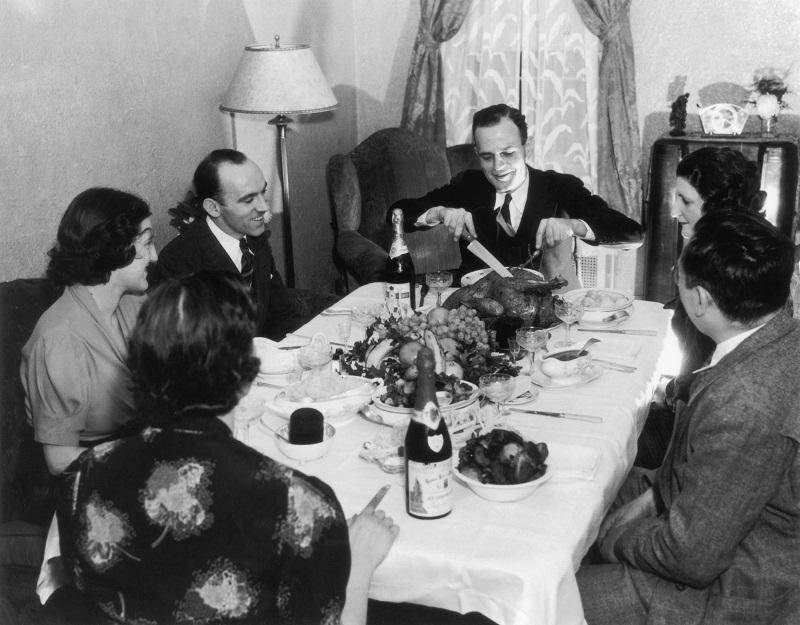 A family sit down to Thanksgiving dinner, circa 1935.
