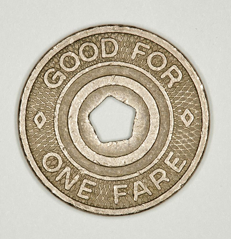 Subway token, ca. 1995-2002.