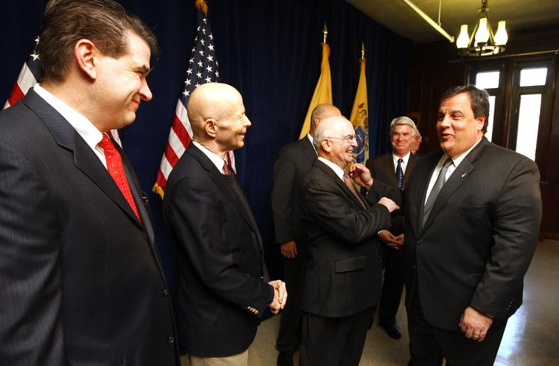 Gov. Chris Christie talks with from left, Fort Lee Mayor Mark Sokolich, after holding a press conference on Sick Pay Reform with elected officials at the National Guard Armory in Teaneck, N.J.