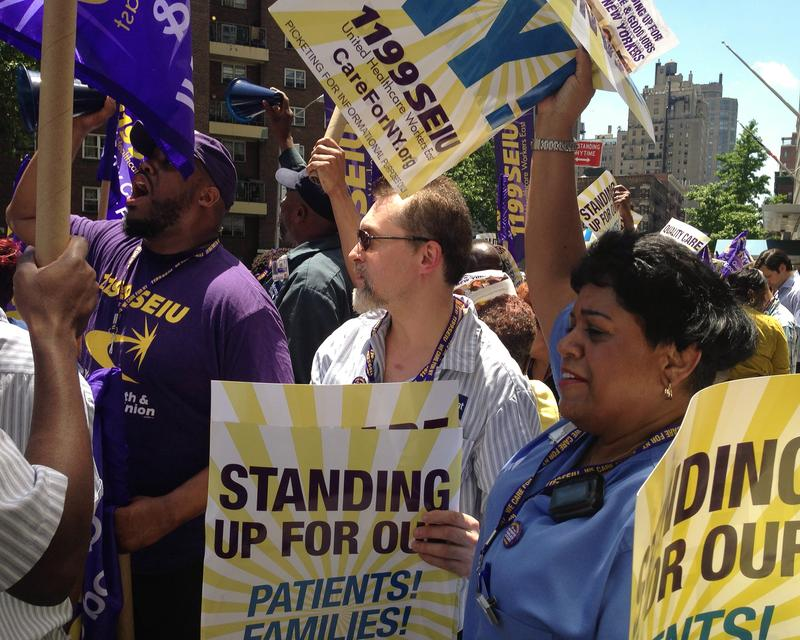 Nurses, caregivers and healthcare workers from 1199 SEIU rallied outside of Mount Sinai Hospital to continue their free healthcare coverage.