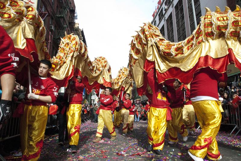 Pupeteers carry two traditional Chinese dragons at the Lunar New Year parade in Chinatown, NY.