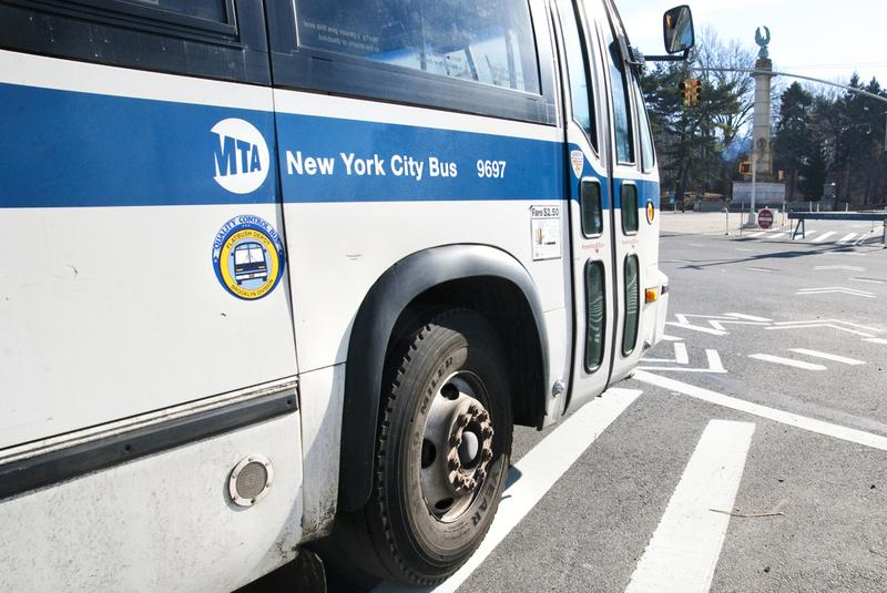A New York City bus turns a corner in Brooklyn.