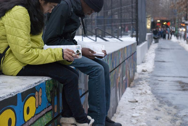 Students study in the cold outside Stuyvesant High School in Manhattan.